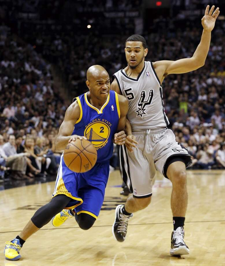 Golden State Warriors' Jarrett Jack drives around San Antonio Spurs' Cory Joseph during first half action of Game 5 in the NBA Western Conference semifinals Tuesday May 14, 2013 at the AT&T Center.