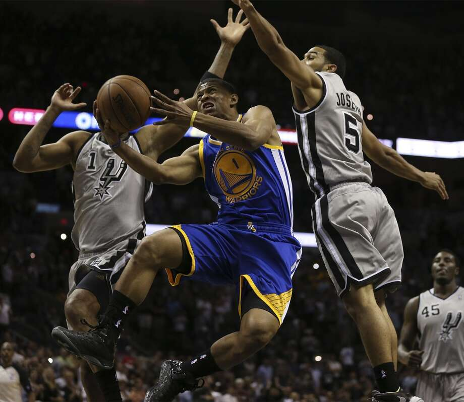 Golden State Warriors' Scott Machado drives between San Antonio Spurs' Tracy McGrady, left, and Cory Joseph during the second half of Game 5 in the NBA Western Conference semifinals at the AT&T Center, Tuesday, May 14, 2013. The Spurs won 109-91 and lead the series at 3-2.