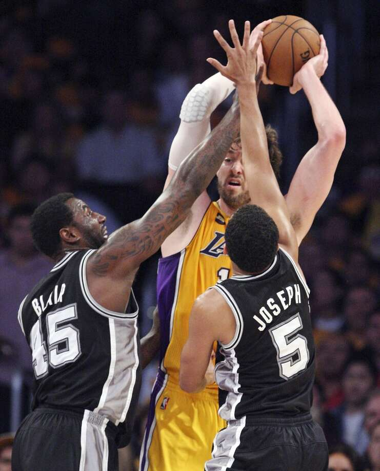 L.A. big man Pau Gasol, bottled up by the Spurs' DeJuan Blair (left) and Cory Joseph during first half action of game 3 in the first round of the NBA Playoffs Friday April 26, 2013 at the Staples Center in Los Angeles, CA.