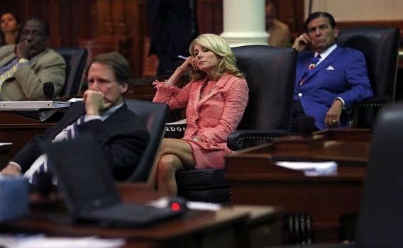 Senator Wendy Davis (D-Fort Worth) watches the debate wind down as the Senate debates passage of abortion legislation on July 12, 2013. Photo: Tom Reel, San Antonio Express-News