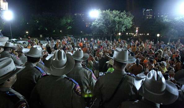 DPS troopers keep protestors from re-entering the Capitol building after the Senate debates passes abortion legislation on July 12, 2013. Photo: TOM REEL