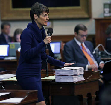 Senator Donna Campbell cites documents to support her case as the Senate debates passage of abortion legislation on July 12, 2013. Photo: Tom Reel, San Antonio Express-News