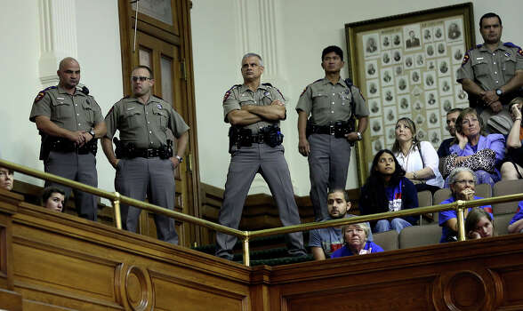 DPS troopers watch over the remaining crowd as the Senate debates passage of abortion legislation on July 12, 2013. Photo: Tom Reel, San Antonio Express-News