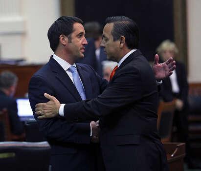 Senator Glenn Hegar (R-Katy) is congratulated by Carlos Uresti (D-San Antonio) after Senate passes abortion legislation on July 12, 2013. Photo: Tom Reel, San Antonio Express-News