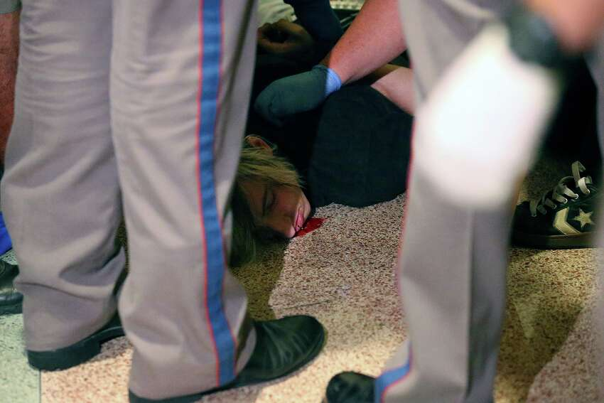 DPS officers stabilize a man after he was injured in the ruckus after the Senate passes abortion legislation on July 12, 2013.