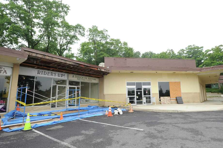 A roped-off area, left, at the North Street Shopping Center at 1043 North Street in the Banksville section of Greenwich, Saturday, July 13, 2013. Photo: Bob Luckey / Greenwich Time