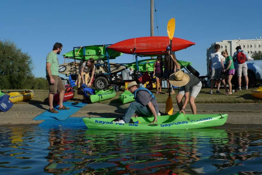 Staff from Bayou Kayaks help paddlers get ready on Bayou St. John in New Orleans.