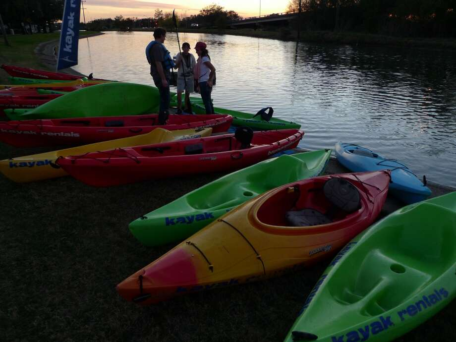 Kayakers return before sunset on Bayou St. John. Some outfitters lead nighttime tours of the bayou.