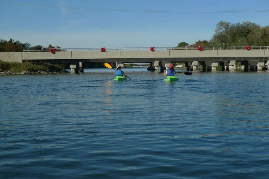 A pair of kayakers prepares to paddle under another bridge on Bayou St. John.