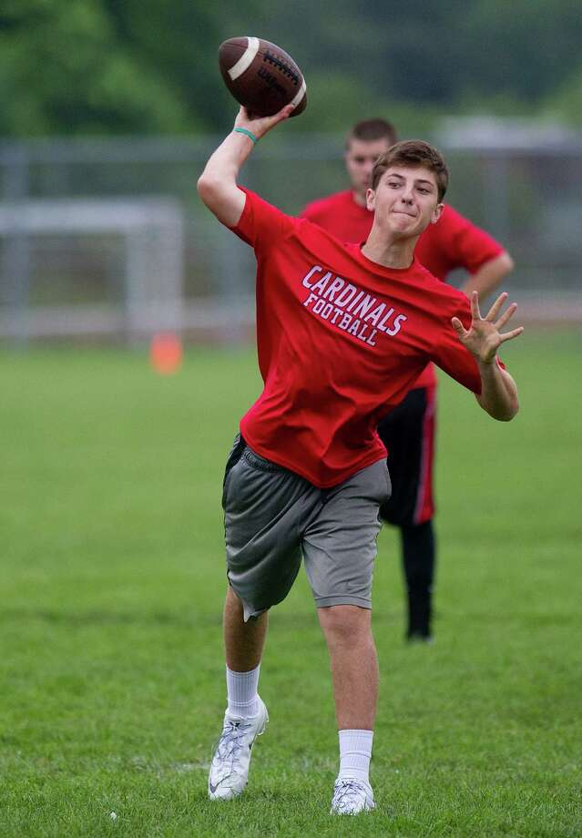 "Greenwich's Matt Marzulla throws a pass during Saturday's ""Grip It and Rip It"" high school football passing camp and competition at New Canaan High School on July 13, 2013. Photo: Lindsay Perry / Stamford Advocate"