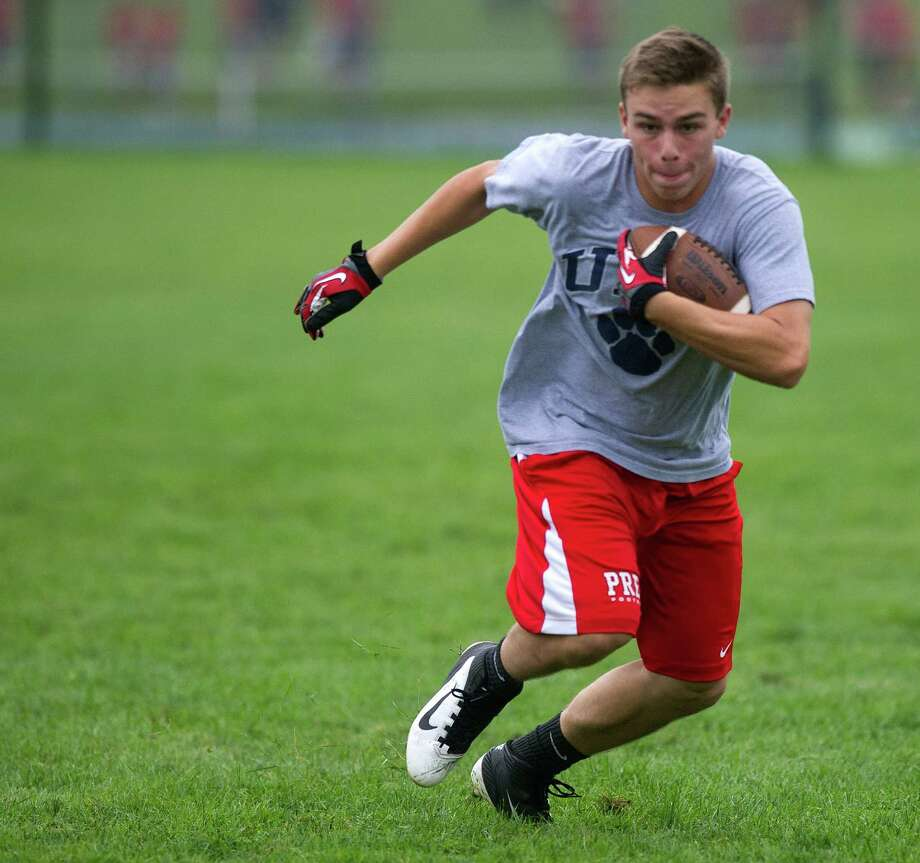 "Fairfield Prep's Joe Ganim carries the ball during Saturday's ""Grip It and Rip It"" high school football passing camp and competition at New Canaan High School on July 13, 2013. Photo: Lindsay Perry / Stamford Advocate"