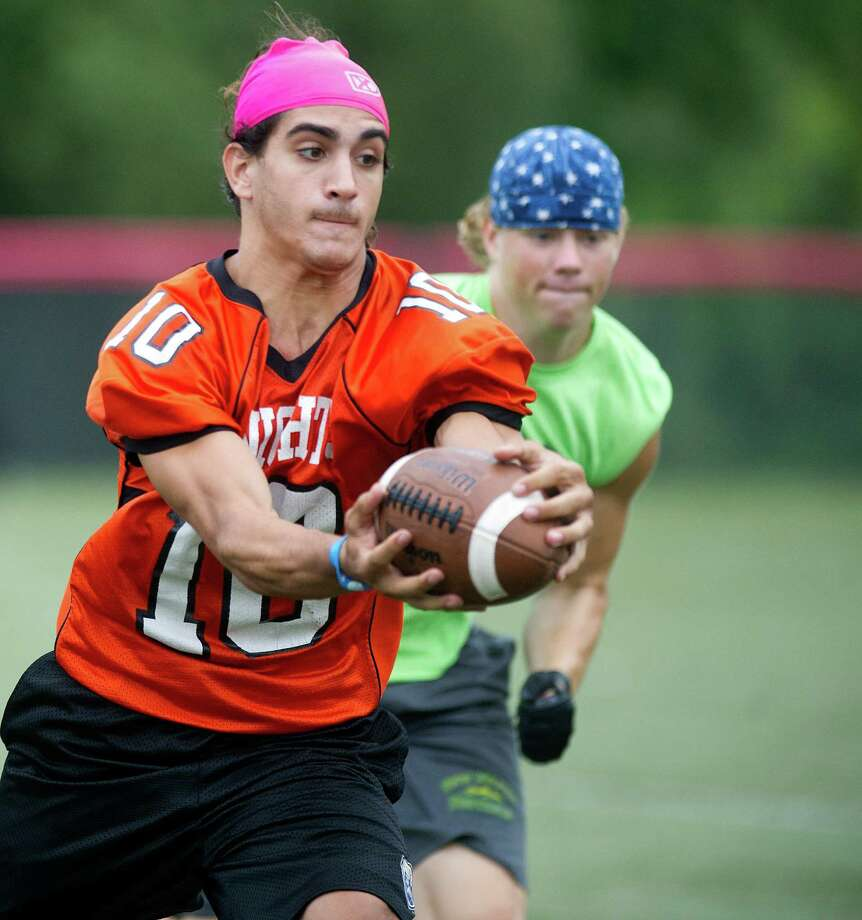 "Stamford's Jake Bivona makes a catch during Saturday's ""Grip It and Rip It"" high school football passing camp and competition at New Canaan High School on July 13, 2013. Photo: Lindsay Perry / Stamford Advocate"