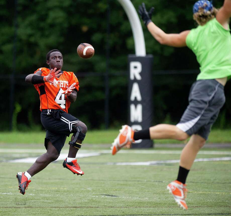 "Stamford's Jerry Aime makes a catch during Saturday's ""Grip It and Rip It"" high school football passing camp and competition at New Canaan High School on July 13, 2013. Photo: Lindsay Perry / Stamford Advocate"