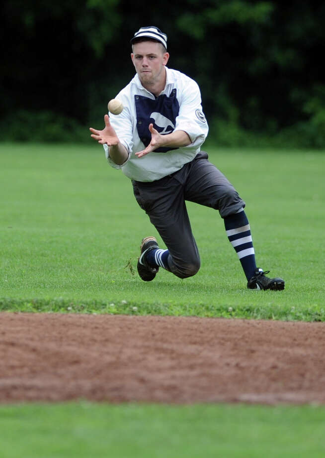 "Mike Vaillancourt, of East Hartford, aka ""Milkman,"" catches the ball for Billy Barney's Blue Boys during their exhibition game against the Nutmegs Saturday, July 13, 2013 on the field at VeteranâÄôs Park in Easton, Conn.  The Historical Society of Easton and EastonâÄôs Department of Parks and Recreation sponsored the vintage baseball games and teams played using 1860's rules. Photo: Autumn Driscoll / Connecticut Post"