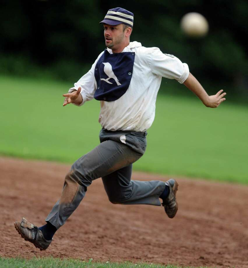 "Billy Barney's Blue Boys' Eric LaPointe, of East Hartford, aka ""Fingers,"" runs to third base during their exhibition game against the Nutmegs Saturday, July 13, 2013 on the field at VeteranâÄôs Park in Easton, Conn.  The Historical Society of Easton and EastonâÄôs Department of Parks and Recreation sponsored the vintage baseball games and teams played using 1860's rules. Photo: Autumn Driscoll / Connecticut Post"
