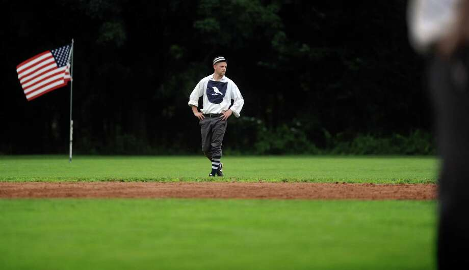 "Eric LaPointe , of East Hartford, aka ""Milkman,"" plays left field for Billy Barney's Blue Boys during their exhibition game against the Nutmegs Saturday, July 13, 2013 on the field at VeteranâÄôs Park in Easton, Conn.  The Historical Society of Easton and EastonâÄôs Department of Parks and Recreation sponsored the vintage baseball games and teams played using 1860's rules. Photo: Autumn Driscoll / Connecticut Post"