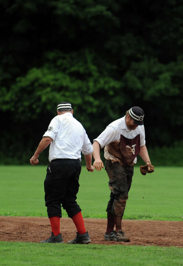 The Nutmegs and Billy Barney's Blue Boys, of the Coltsville Vintage Baseball League, play an exhibition game with 1860 rules on the field at VeteranâÄôs Park in Easton, Conn. Saturday, July 13, 2013. Photo: Autumn Driscoll / Connecticut Post