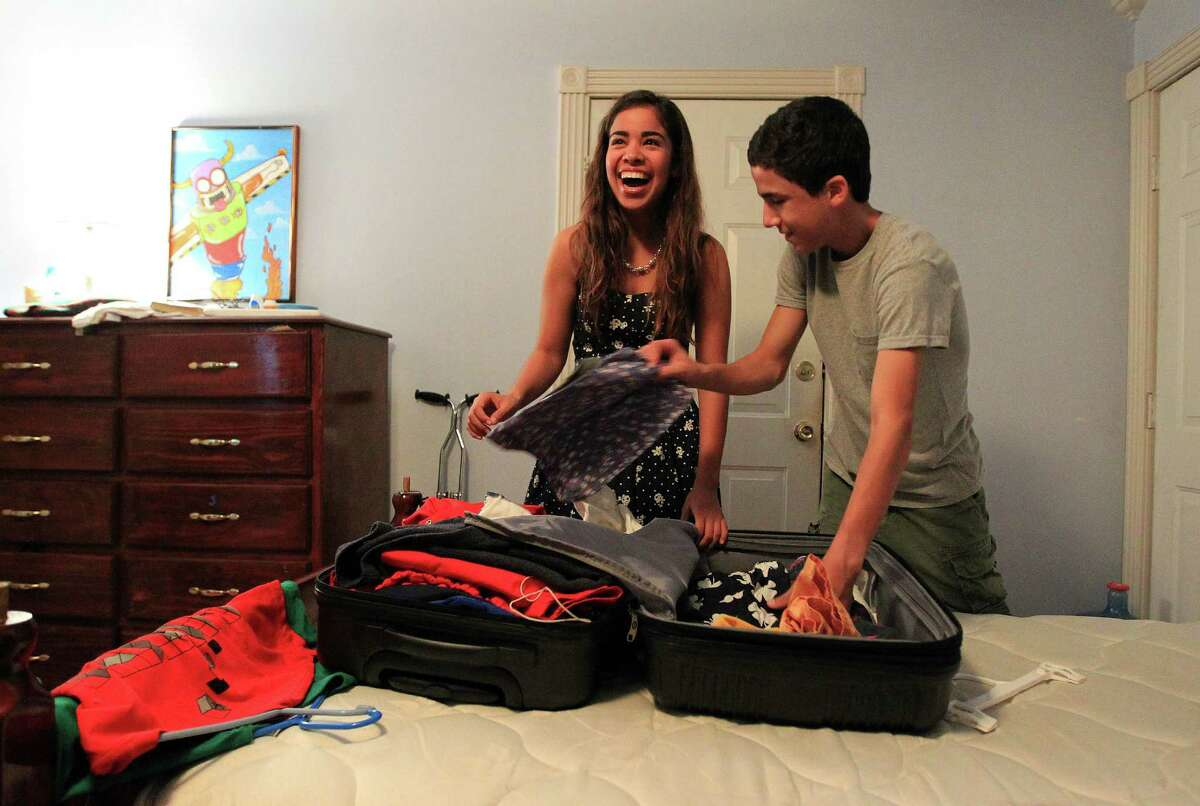 Diego Rivera, 15, gets some help from his sister, Brianna, 16, for his upcoming trip to Donner Pass, part of The Woods Project.
