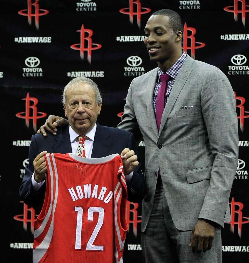 Rockets owner Leslie Alexander poses with center Dwight Howard. Photo: Karen Warren, Houston Chronicle
