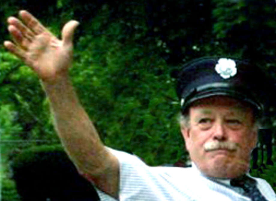 Bill Stuart, shown here riding in a town parade several years ago, will not seek reelection in November 2013 after 30 years' service as Bridgewater's first selectman. Photo: Walter Kidd