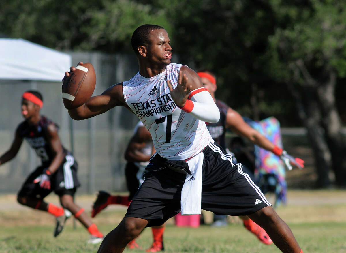 Lamar senior quarterback Darrell Colbert aims for a receiver against The Woodlands during their elimination game at the 2013 Division 7-on-7 State Championship at Southwest County Regional Park in Leander on Saturday.