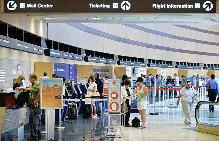 Travelers at the ticket counters at Albany International Airport in Colonie, NY Wednesday July 10, 2013.  (John Carl D'Annibale / Times Union) Photo: John Carl D'Annibale / 10023123A