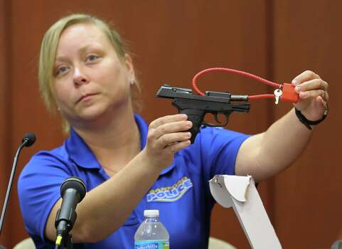 June 25, 2013 – Crime scene technician Diana Smith answers questions about the scene of the shooting the night of Trayvon Martin's death. Details include information on Zimmerman's gun. Photo: AP