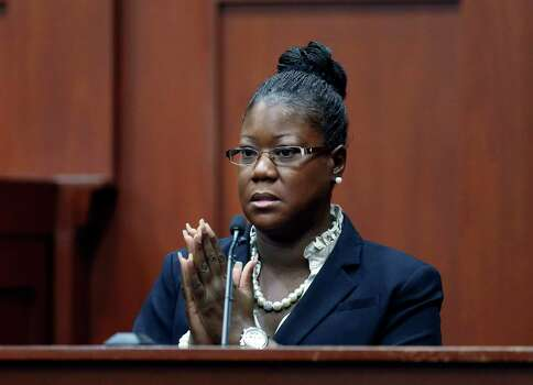 July 5, 2013 – Trayvon Martin's mother Sybrina Fulton testifies that she is sure the voice heard screaming for help on a call to police is her son. In later testimony, Trayvon's brother would concur, but Martin's father would testify that he originally could not identify the voice as his son immediately following the shooting. Photo: Orlando Sentinel, Gary W. Green, Pool
