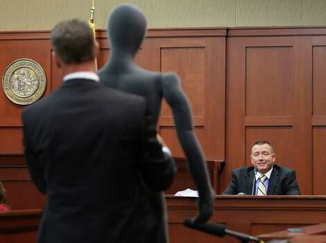 July 10, 2012 – Assistant state attorney John Guy uses a foam dummy to describe the altercation between George Zimmerman and Trayvon Martin to defense witness and law enforcement expert Dennis Root. Root testifies that he didn't see anything wrong with Zimmerman's actions the night of the shooting. Photo: Orlando Sentinel, Gary W. Green, Pool