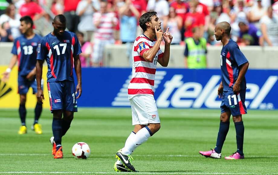 Chris Wondolowski of the US celebrates scoring his second goal against Cuba as Jorge Enrique Ramos (#13), Alexy Zuaznabar (#17) and Ariel Pedro Martinez (#11) look on during their Gold Cup soccer match in Sandy, Utah, on July 13, 2013, where the US defeated Cuba 4-1. AFP PHOTO / Frederic J. BROWNFREDERIC J. BROWN/AFP/Getty Images Photo: Frederic J. Brown, AFP/Getty Images