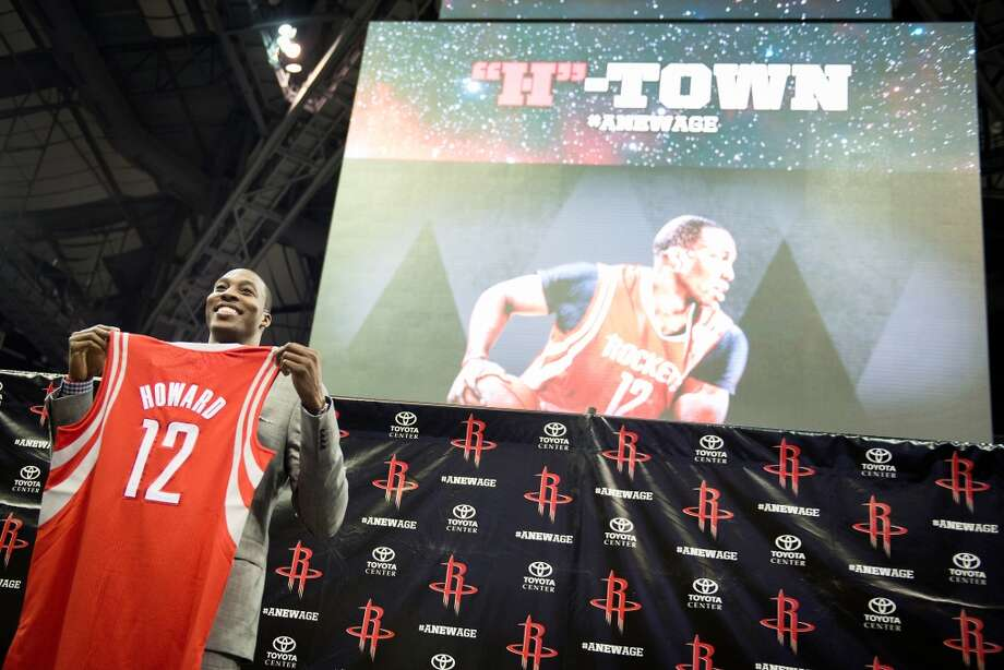 Rockets center Dwight Howard poses with his new jersey. Photo: Smiley N. Pool, Houston Chronicle