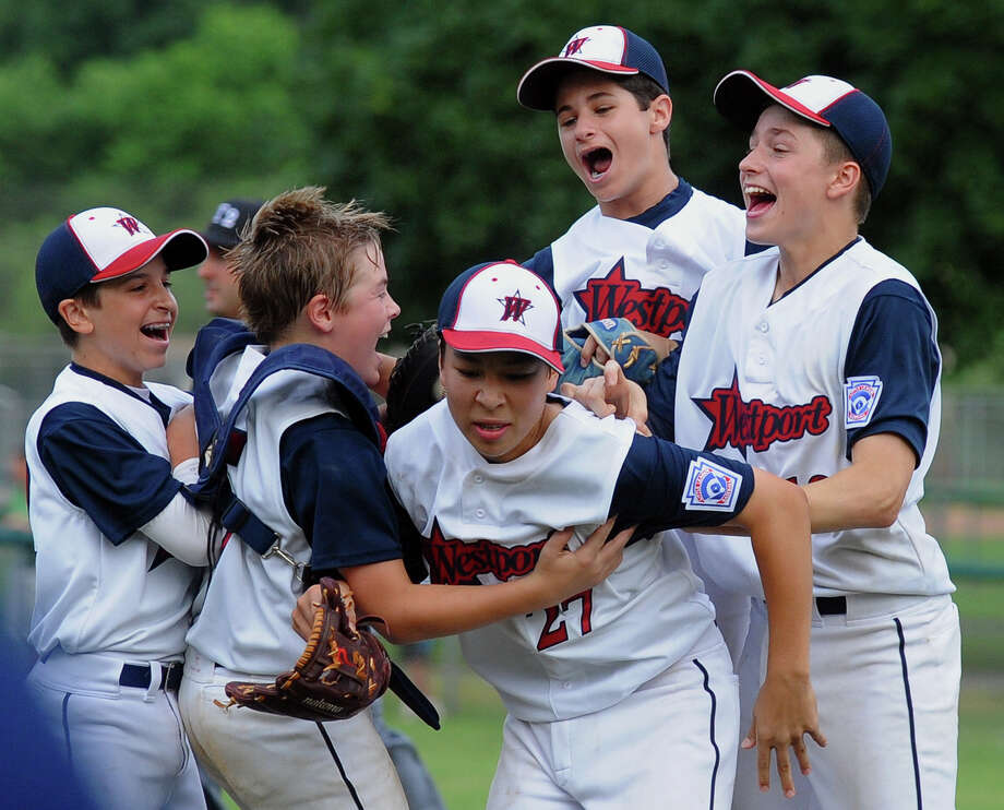 Westport team members surround pitcher Chad Knight, center, and celebrate their win over Fairfield National during District 2 little league action at Unity Park in Trumbull, Conn. on Saturday July 13, 2013. Photo: Christian Abraham / Connecticut Post