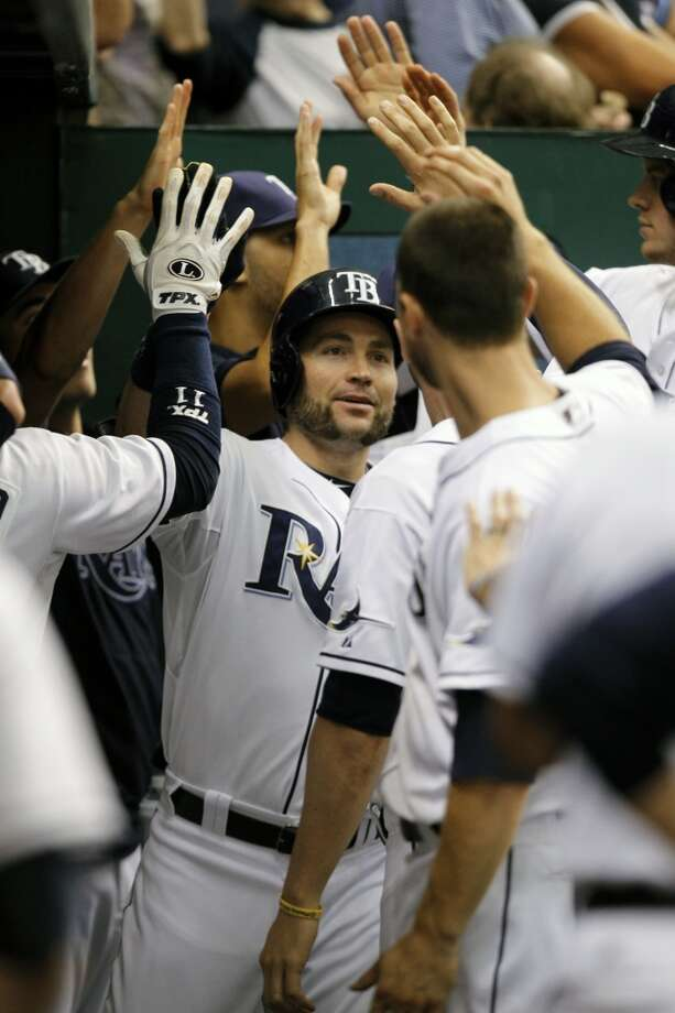 Luke Scott celebrates with teammates after hitting a two-run home run.