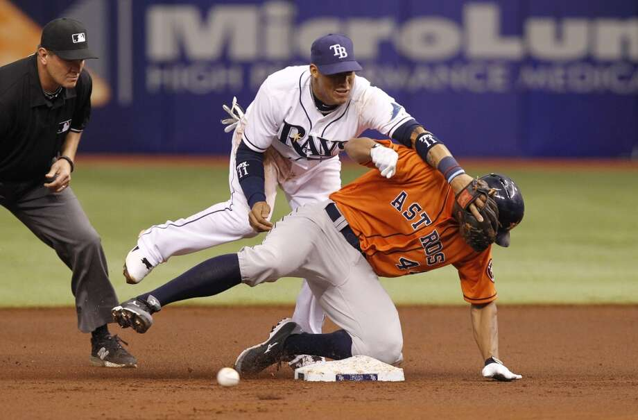 Rays shortstop Yunel Escobar is unable to field the ball as Justin Maxwell slides safely into second.
