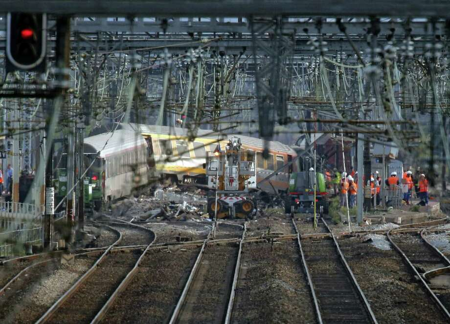 An official said Saturday that a faulty rail joint might have caused a train derailment outside Paris that left six people dead Friday. Photo: Jacques Brinon / Associated Press