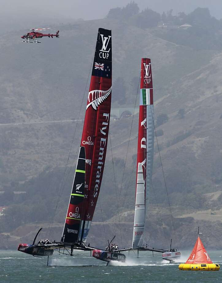 Emirates Team New Zealand shows an early lead over Luna Rossa as they approach the first marker. Photo: Paul Chinn, The Chronicle