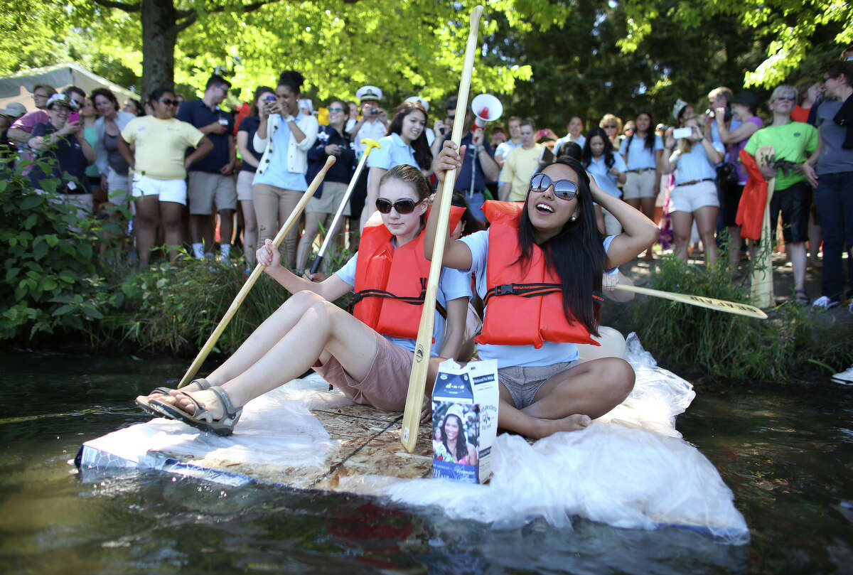 The Seafair Princesses prepare to depart during the annual Seafair Milk Carton Derby at Green Lake in Seattle. The Seafair royalty eventually all abandoned their boat during the race.