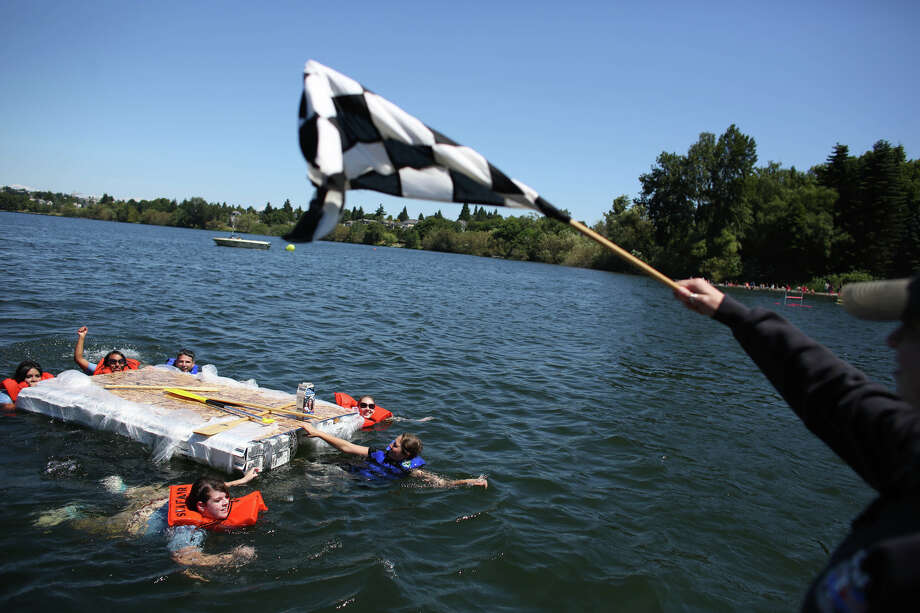 The Seafair Princesses swim their boat across the finish line after bailing from the vessel. Photo: JOSHUA TRUJILLO, SEATTLEPI.COM