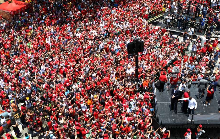 Houston Rockets fans surround a stage with Dwight Howard outside the Toyota Center. Photo: Karen Warren, Houston Chronicle