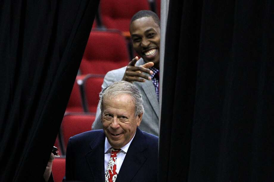 Houston Rocket's owner Les Alexander comes out from behind the curtain as Dwight Howard smiles. Photo: Karen Warren, Houston Chronicle