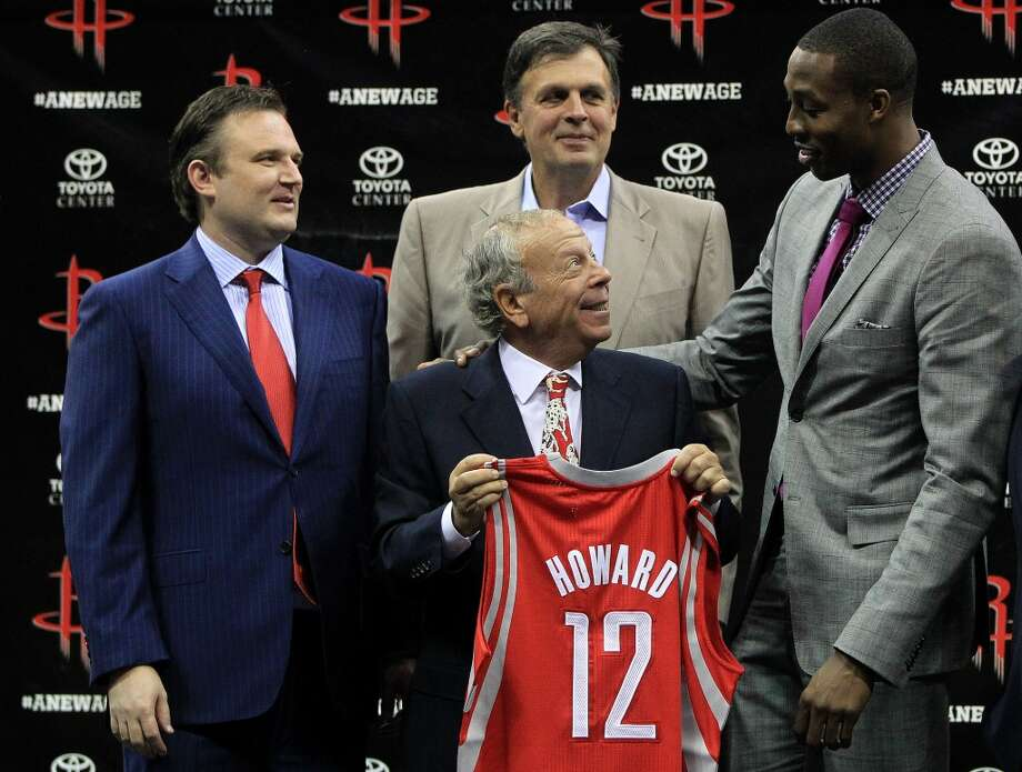 Houston Rockets owner Les Alexander holds Dwight Howard's jersey with general manager Daryl Morey, left, and head coach Kevin McHale. Photo: Karen Warren, Houston Chronicle