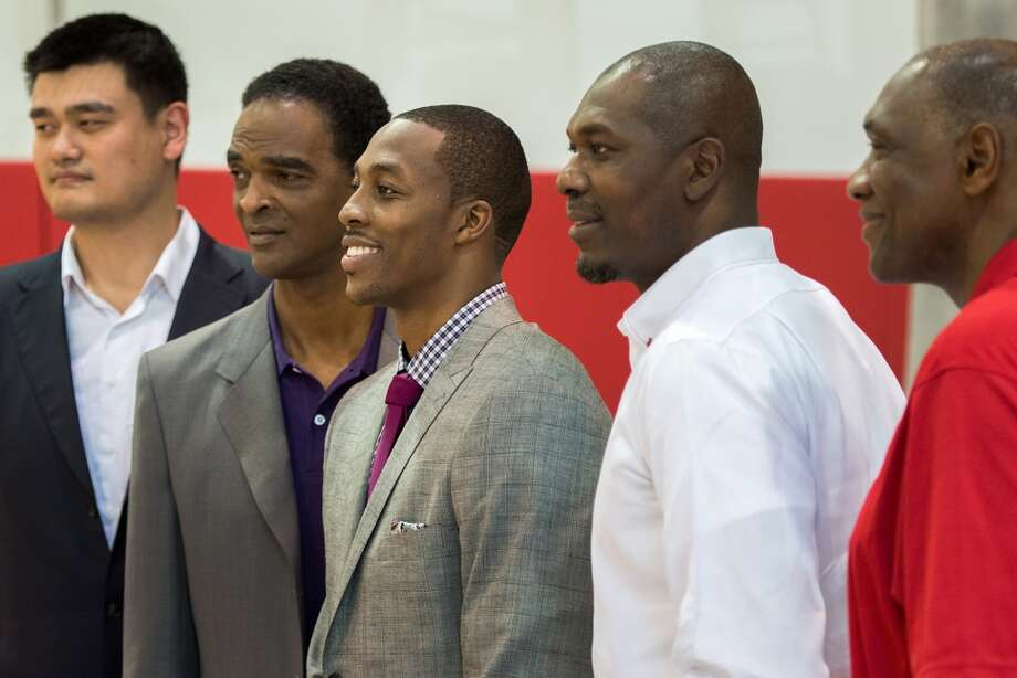 Dwight Howard, center, poses for a group photo with, from left, Yao Ming, Ralph Sampson, Hakeem Olajuwon and Elvin Hayes. Photo: Smiley N. Pool, Houston Chronicle