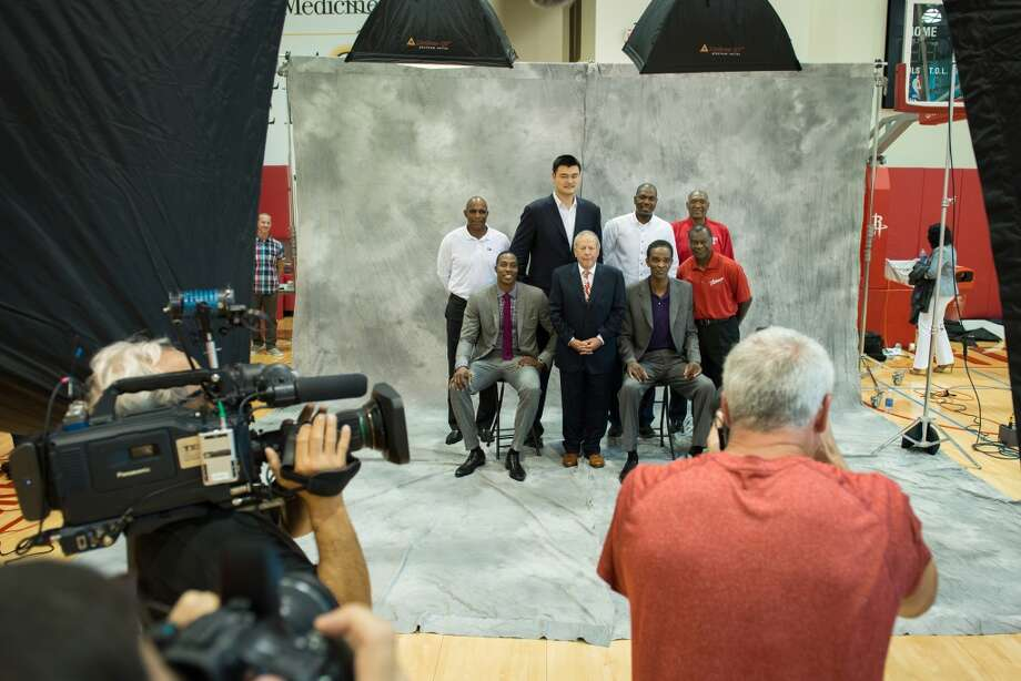 Dwight Howard poses for a group photo with Houston Rockets owner Les Alexander and former players Elvin Hayes, Ralph Sampson, Hakeem Olajuwon, Yao Ming, Clyde Drexler and Calvin Murphy. Photo: Smiley N. Pool, Houston Chronicle