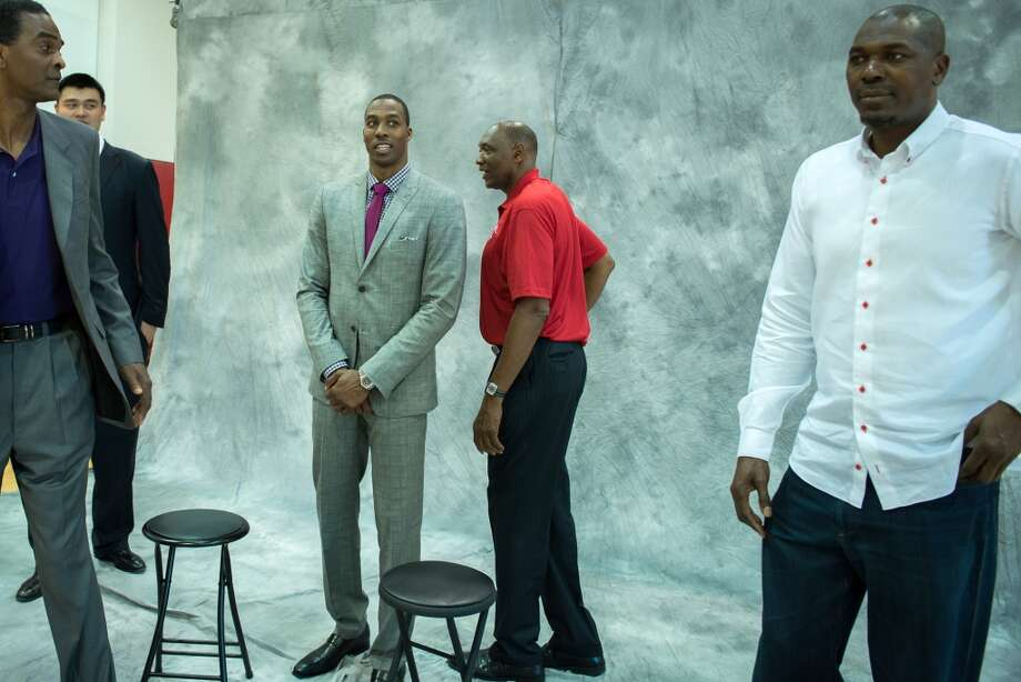 Dwight Howard, center, waits to take a group photo with, from left, Ralph Sampson, Yao Ming, Elvin Hayes and Hakeem Olajuwon. Photo: Smiley N. Pool, Houston Chronicle