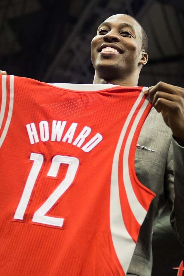 Dwight Howard holds up his new jersey as he is introduced as the newest member of the Houston Rockets. Photo: Smiley N. Pool, Houston Chronicle