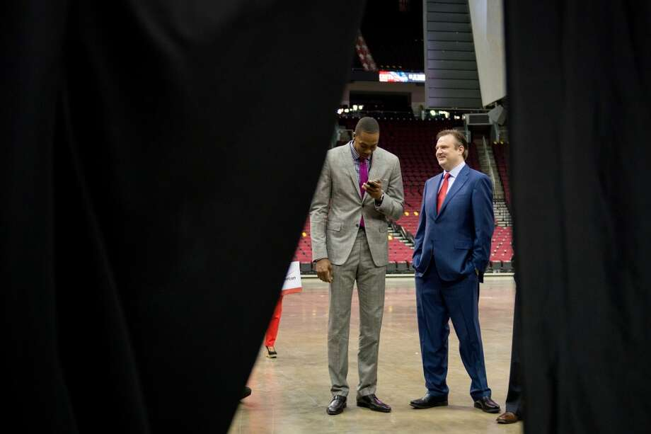 Dwight Howard, left, chats with Houston Rockets general manager Daryl Morey as he waits to be introduced at a press conference. Photo: Smiley N. Pool, Houston Chronicle