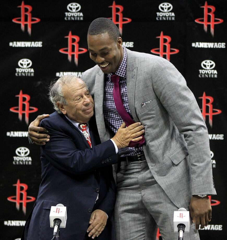 Rockets owner Les Alexander gets a hug from Dwight Howard. Photo: Karen Warren, Houston Chronicle