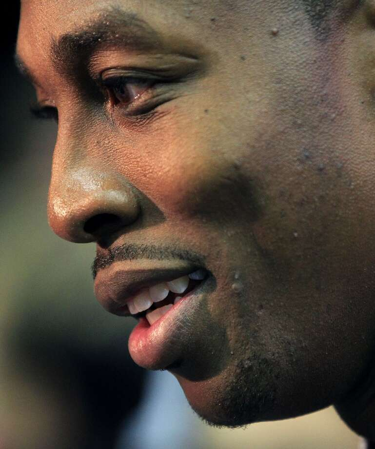 Dwight Howard speaks to the media after the press conference. Photo: Karen Warren, Houston Chronicle