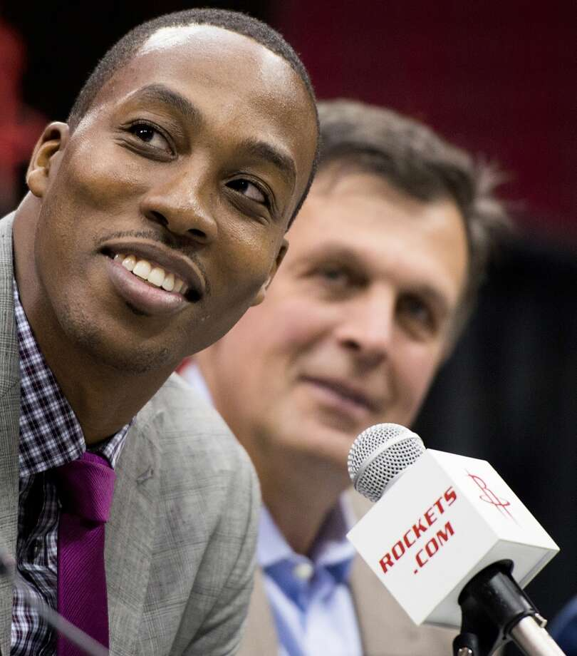 Dwight Howard smiles as he addresses a press conference. Photo: Smiley N. Pool, Houston Chronicle