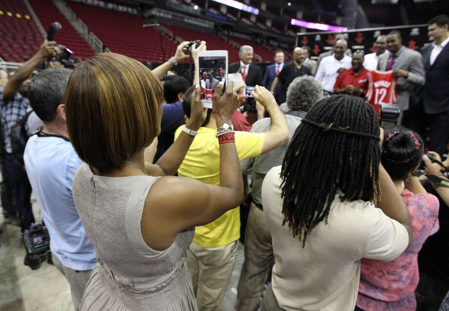 Sheryl Howard, Dwight Howard's mother, takes a photo of Dwight on stage. Photo: Karen Warren, Houston Chronicle